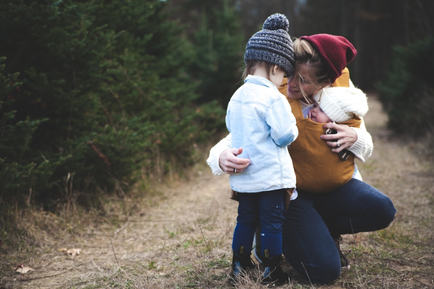 Photo by Josh Willink from Pexels https://www.pexels.com/photo/woman-with-brown-baby-carrier-and-little-kid-in-white-jacket-701014/